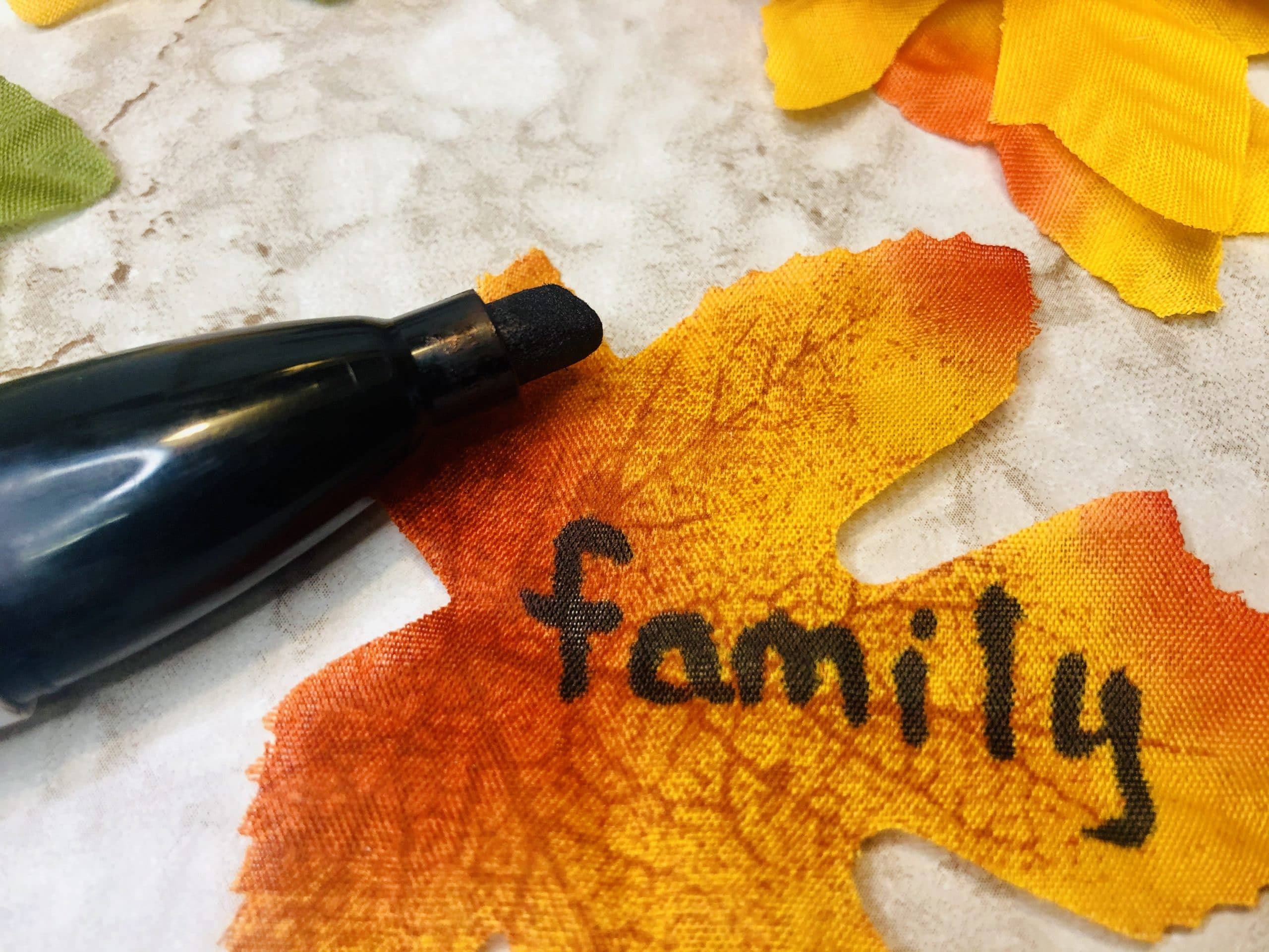 write word on leaf for thankful tree